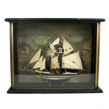 blue nose sailboat in wood shadowbox