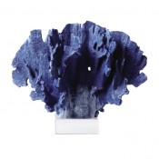 blue coral sculpture on glass base